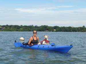 This is a photo of Jody and her dog Navi kayaking.
