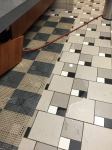 This is a photo of standing water on the floor of the gym bathroom.